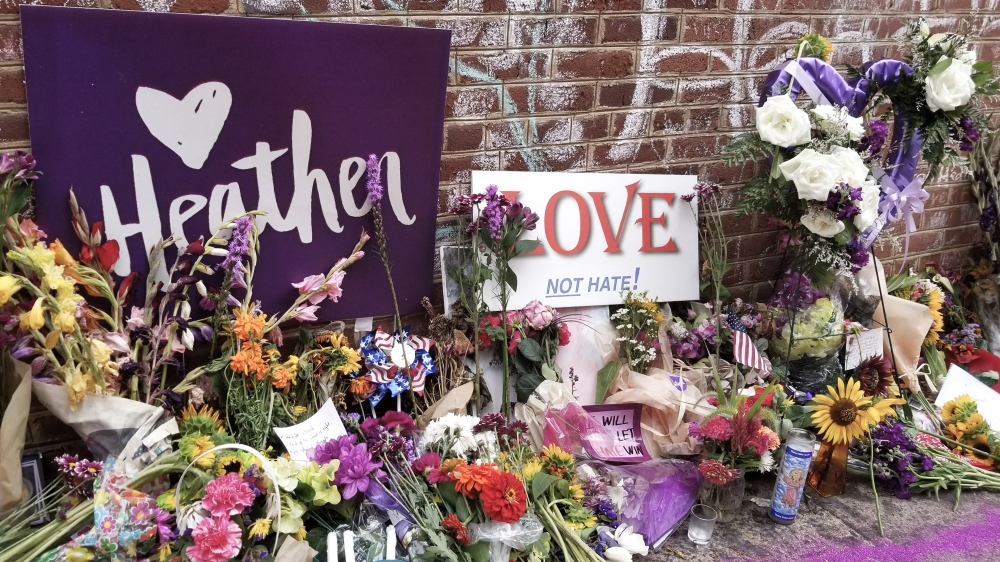 Signs to Heather Heyer on display in Charlottesville near where she was killed by a white supremacist.