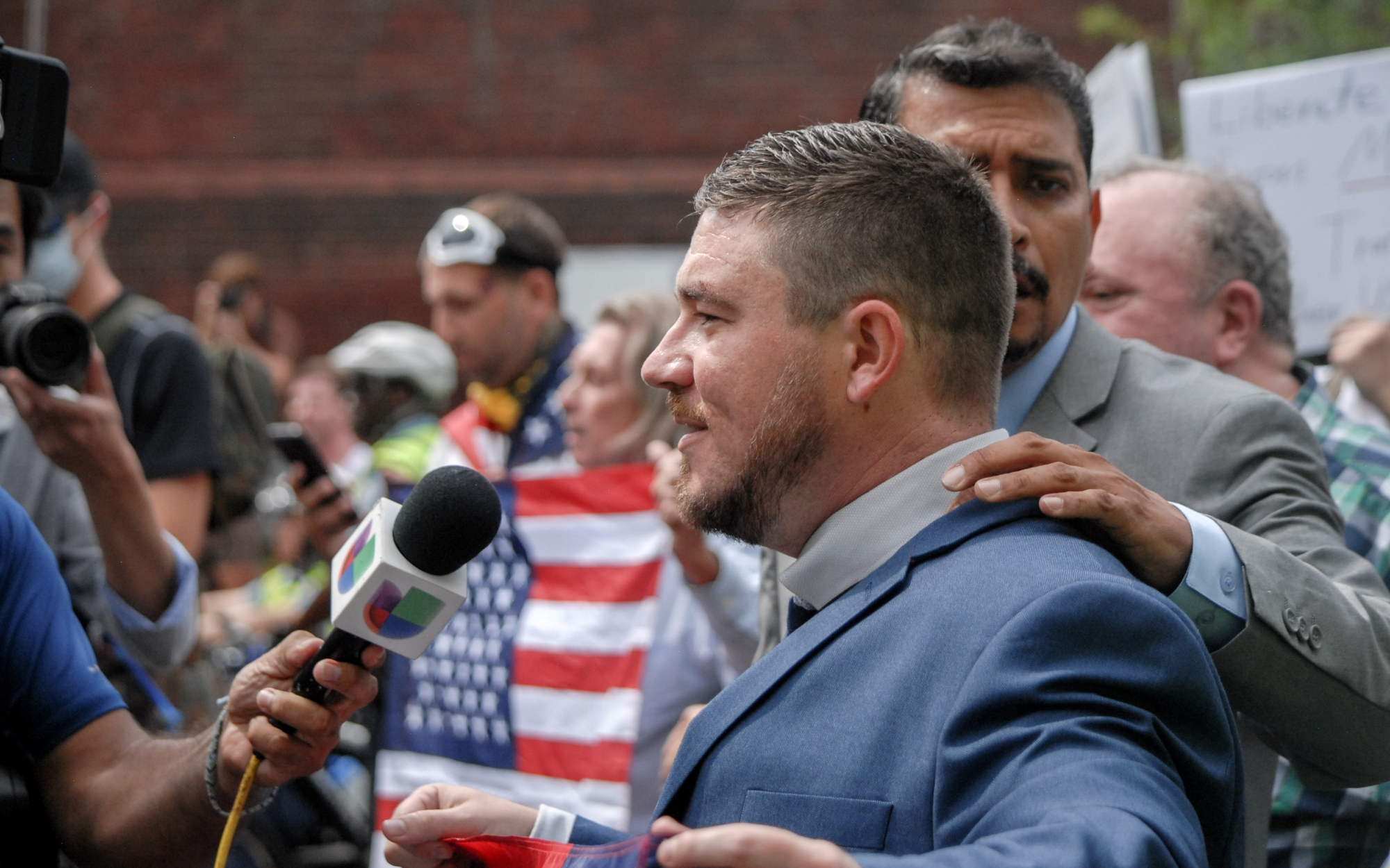 Jason Kessler speaks with reporters at Unite the Right 2 in Washington D.C. on Aug. 12, 2018.